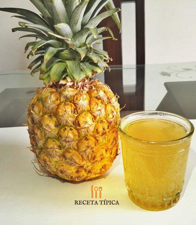 Glass with chicha de piña and pineapple