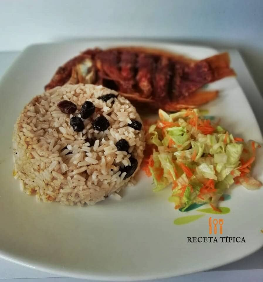 Dish with Coconut rice, salad and fried fish