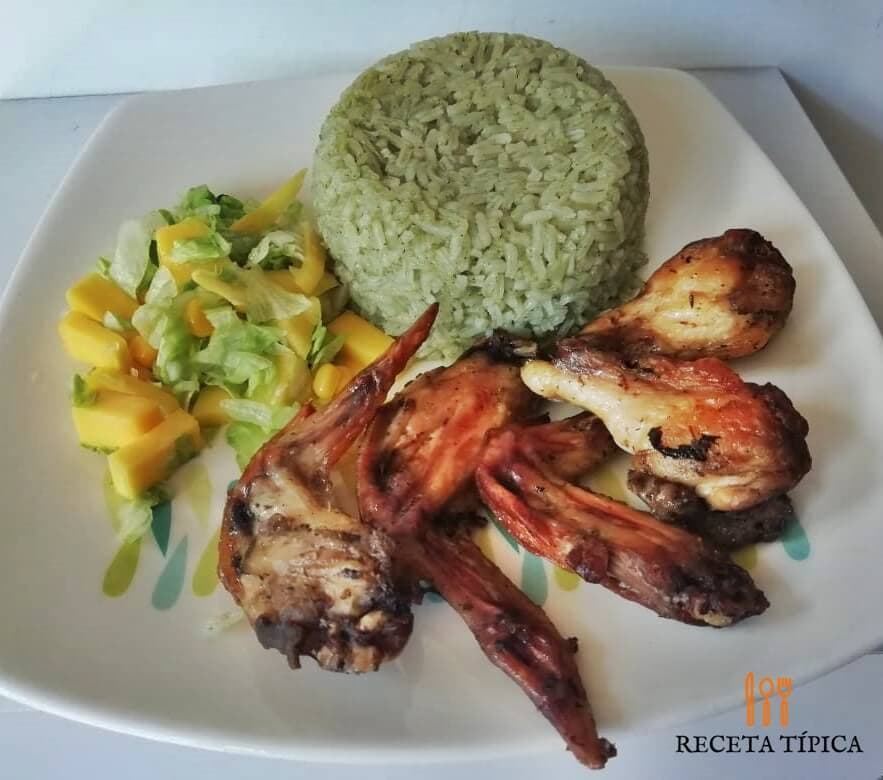 Plate with Herbed Grilled Chicken Wings, green rice and mango salad