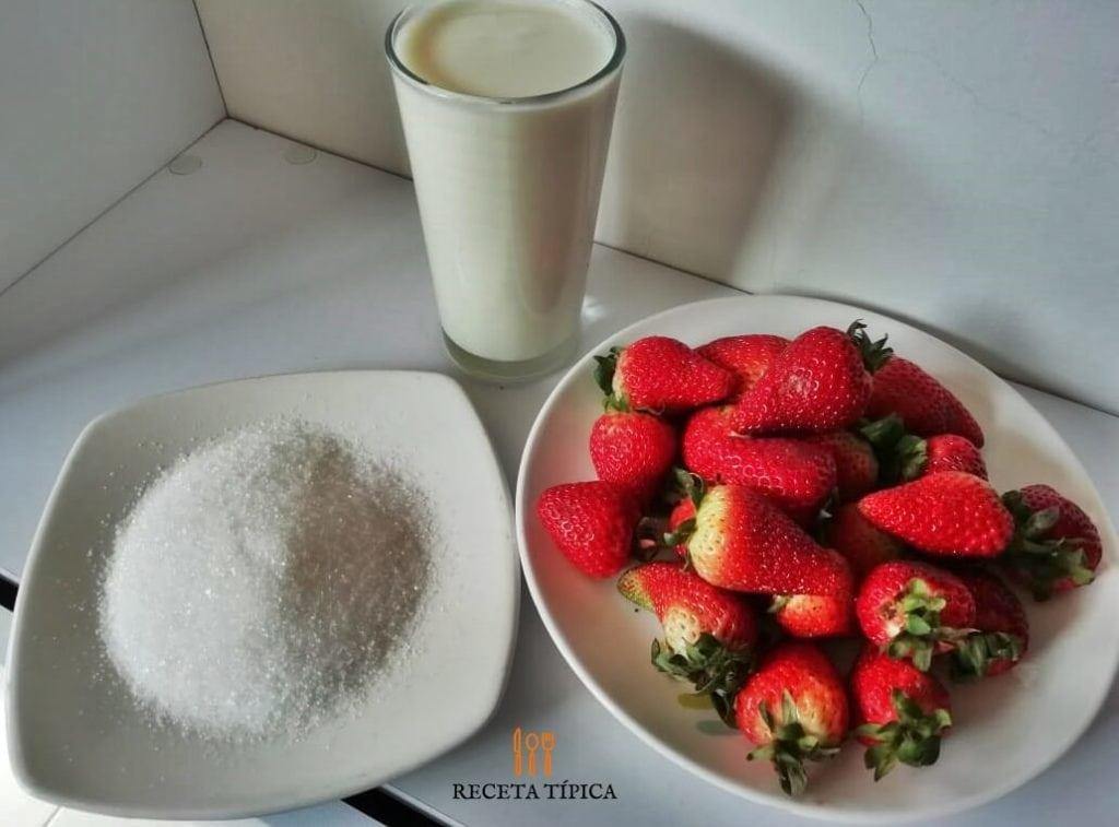Ingredients for preparing strawberry milkshake