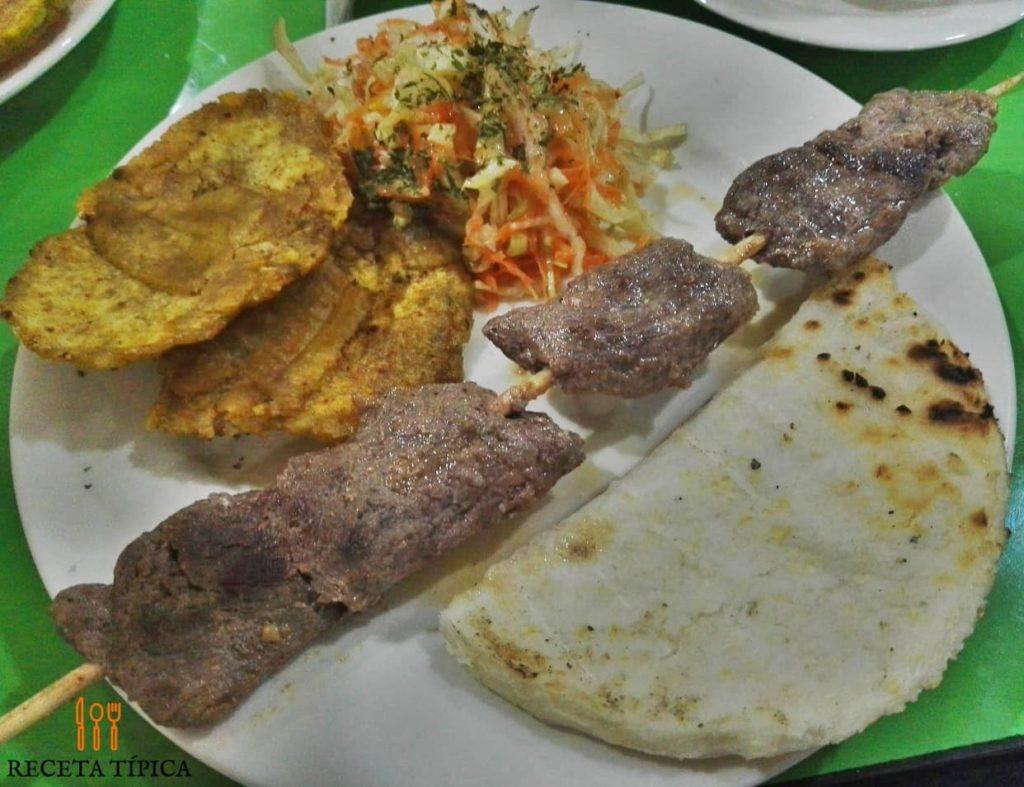 Dish with pork skewers