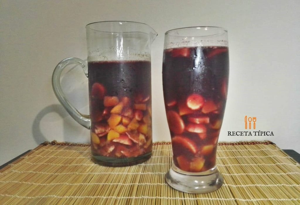 Glass and jar with sangria