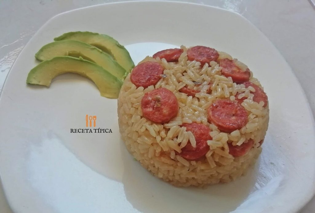 Dish with chorizo rice & avocado slice
